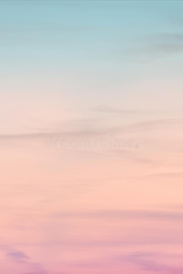 Vertical ratio size of sunset background. sky with soft and blur pastel colored clouds. gradient cloud on the beach resort. Nature. sunrise.  peaceful morning stock photography