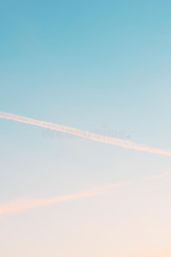 Vertical ratio size of sunset background. sky with soft and blur pastel colored clouds. gradient cloud on the beach resort. Nature. sunrise.  peaceful morning royalty free stock images