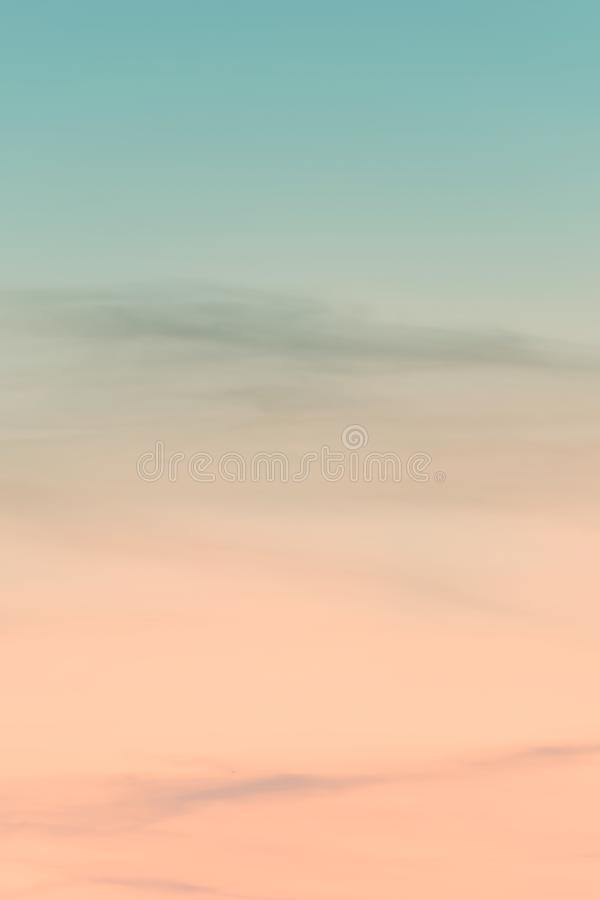 Vertical ratio size of sunset background. sky with soft and blur pastel colored clouds. gradient cloud on the beach resort. Nature. sunrise.  peaceful morning royalty free stock photo