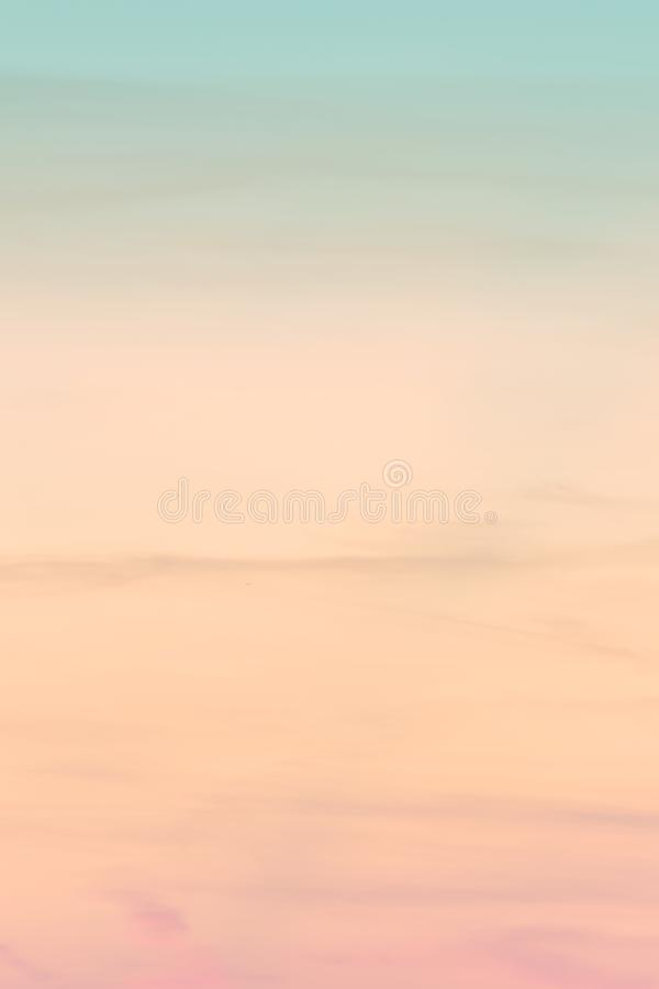 Vertical ratio size of sunset background. sky with soft and blur pastel colored clouds. gradient cloud on the beach resort. Nature. sunrise.  peaceful morning royalty free stock photography