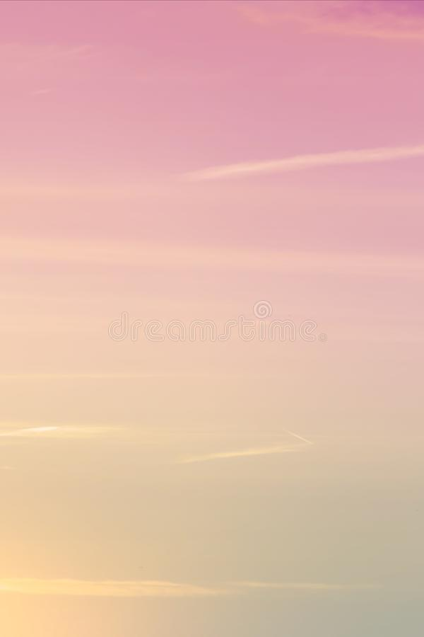Vertical ratio size of sunset background. sky with soft and blur pastel colored clouds. gradient cloud on the beach resort. Nature. sunrise.  peaceful morning royalty free stock photos