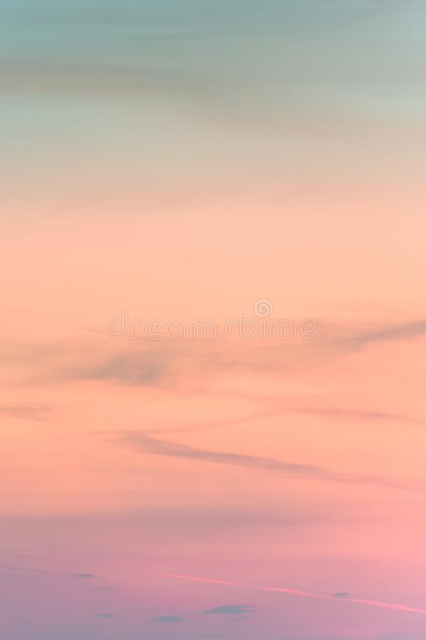 Vertical ratio size of sunset background. sky with soft and blur pastel colored clouds. gradient cloud on the beach resort. Nature. sunrise.  peaceful morning stock image