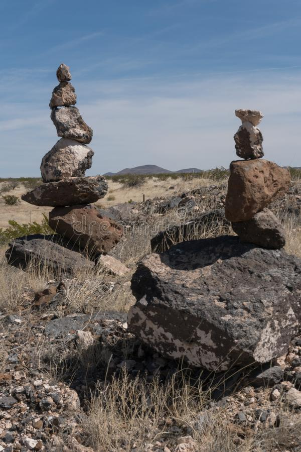 Vertical of rock cairns along state highway nine in New Mexico. stock photo