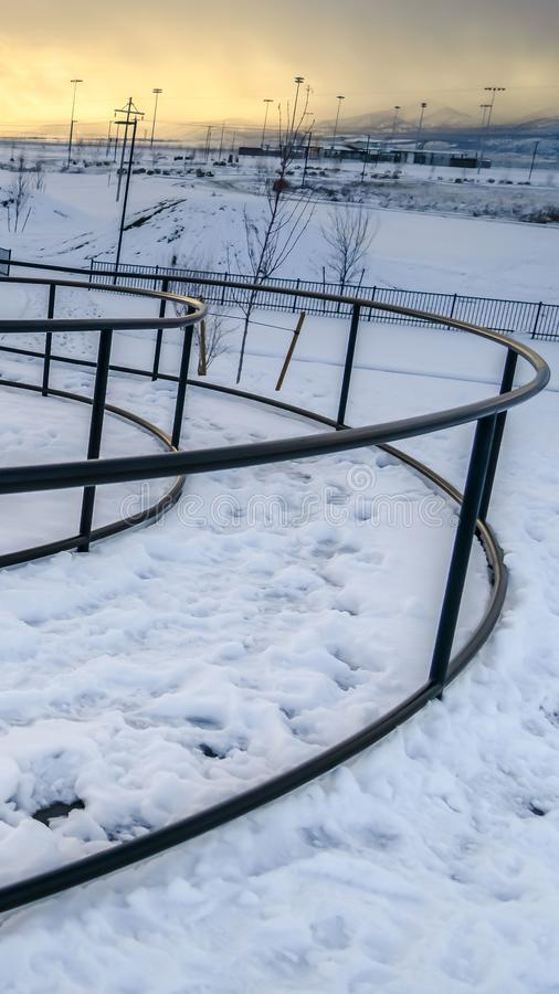 Vertical Rope climbing frame and curving pathway with handrails on a park in winter royalty free stock photos
