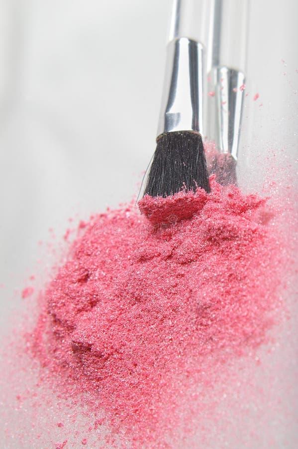 Vertical rosada del polvo fotografía de archivo