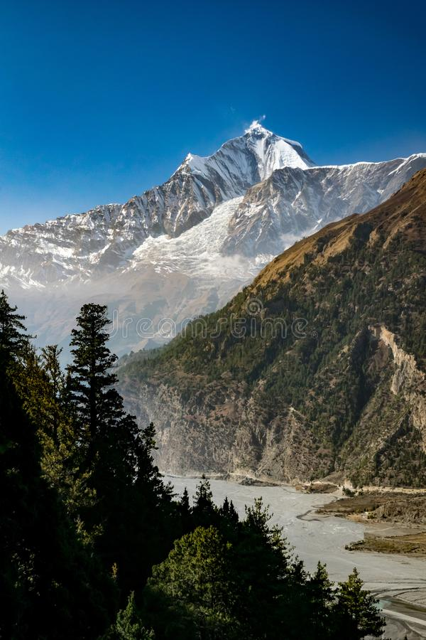 Vertical scenic photo of Gandaki river valley and snowcapped mountain peak, Himalayas royalty free stock photo