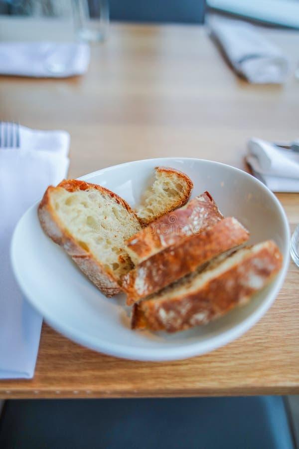 Vertical selective closeup shot of bread slices in a white bowl. A vertical selective closeup shot of bread slices in a white bowl royalty free stock image