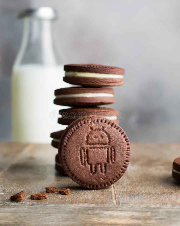 Vertical selective closeup shot of stacked chocolate cookies with white cream filling stock image