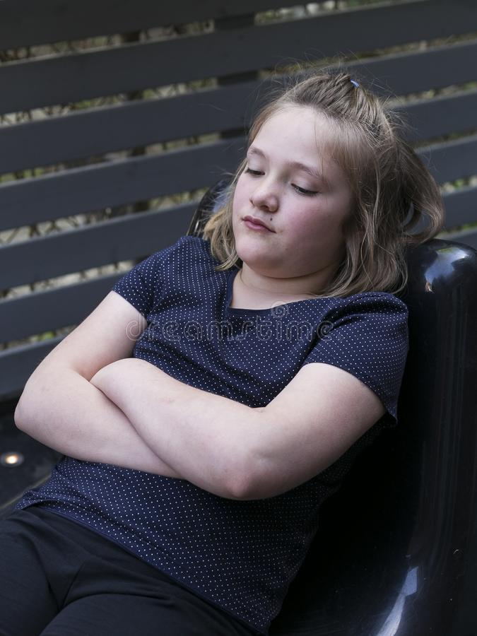 Little girl with eyes half closed and bored expression stock images