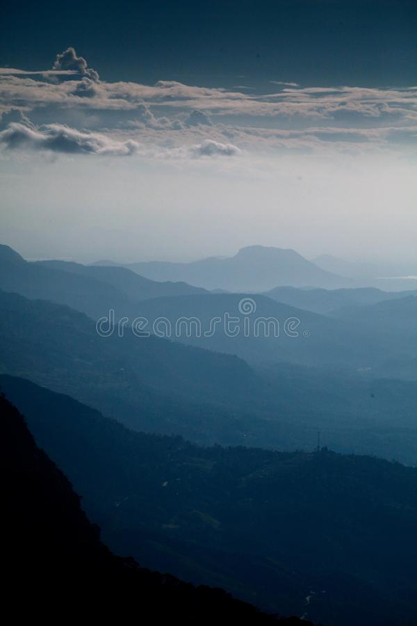 Vertical shot of beautiful mountain range and the cloudy sky in the early morning. A vertical shot of beautiful mountain range and the cloudy sky in the early royalty free stock photography
