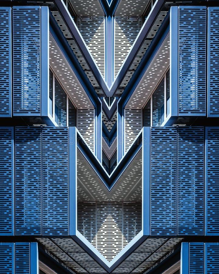 Vertical shot of a beautiful symmetrical blue and white structure. A vertical shot of a beautiful symmetrical blue and white structure royalty free stock photo