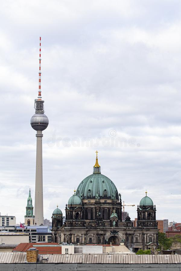 Vertical shot of the Berlin Catehdral and Fernsehturm Television Tower in Berlin, Germany. A vertical shot of the Berlin Catehdral and Fernsehturm Television stock image