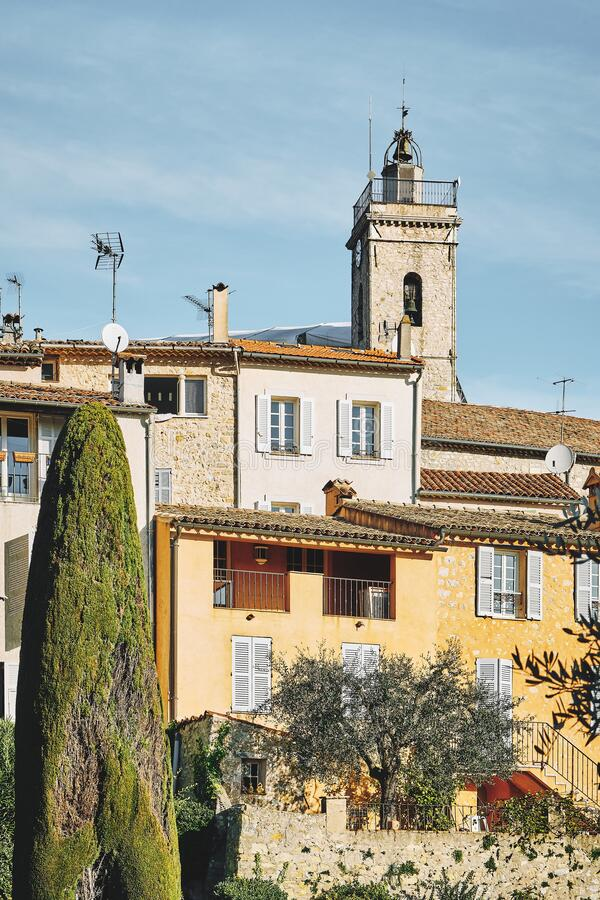 Vertical shot of buildings and a bell tower in the distance in Mougins, France. A vertical shot of buildings and a bell tower in the distance in Mougins, France royalty free stock photo