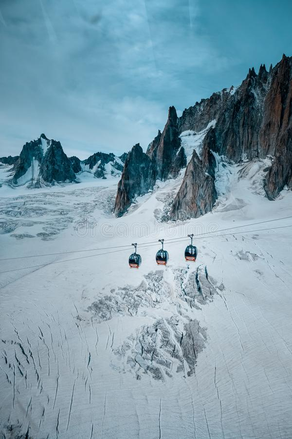 Vertical shot of cable ropeways near ruth glaciers covered in snow. A vertical shot of cable ropeways near ruth glaciers covered in snow royalty free stock photography