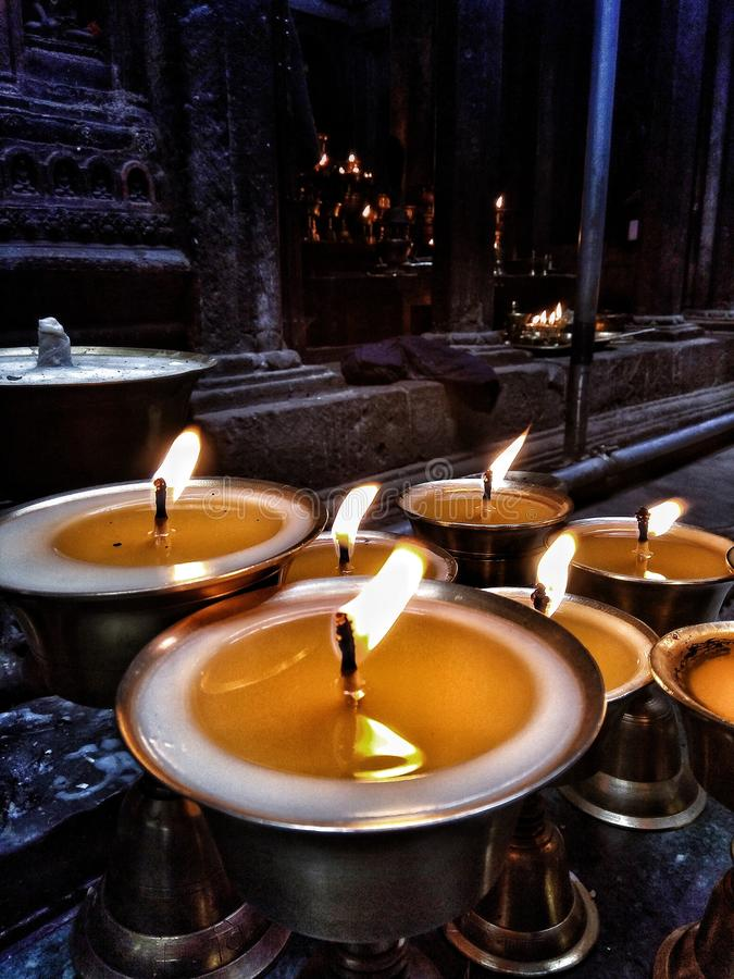 Vertical shot of candles near a temple. A vertical shot of candles near a temple royalty free stock photos