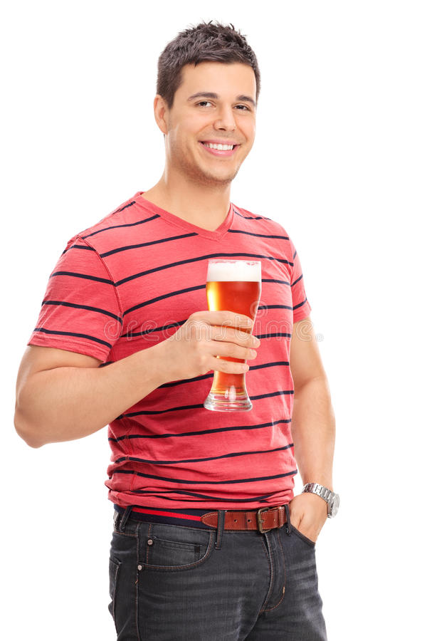 Vertical shot of a casual guy drinking beer. Isolated on white background stock photo
