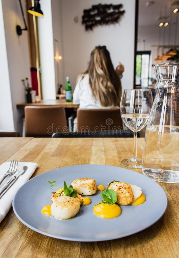 Vertical shot of chicken and shrimps with special sauce on a round blue plate stock photography