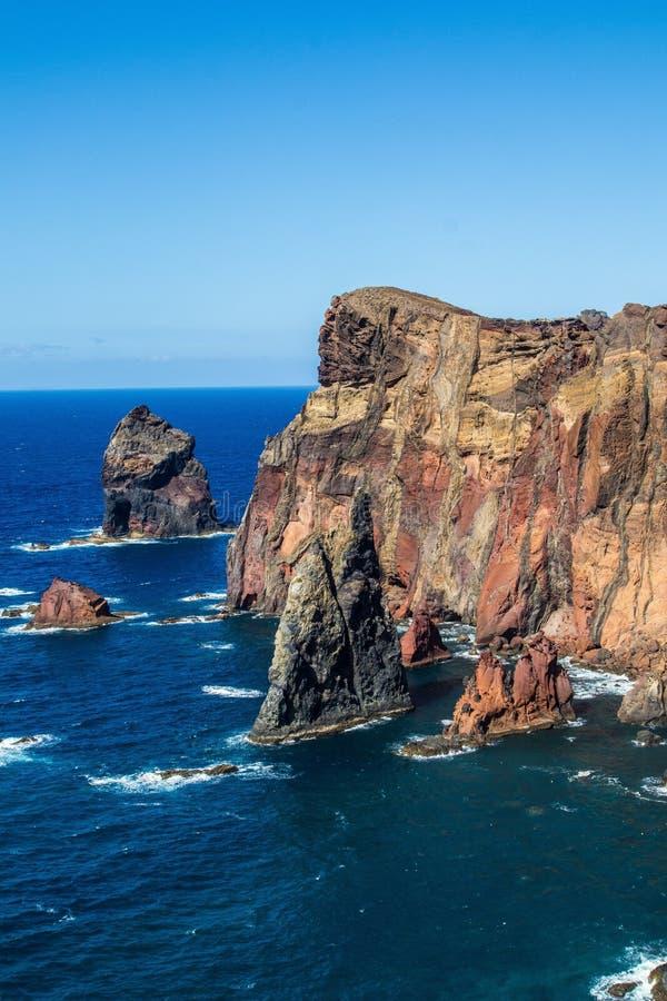 Vertical shot of a cliff at the edge of the ocean in Ponta do Sao Lourenco, Madeira stock photography