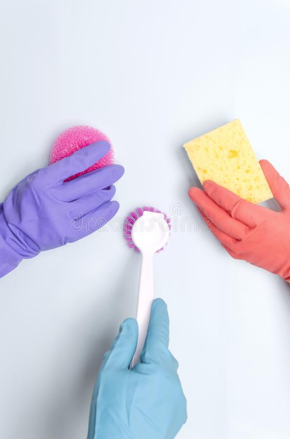 Vertical shot.Concept of cleaning compony and cleaning team.Workers holding variois of cleaning supplies for washing and removing royalty free stock image
