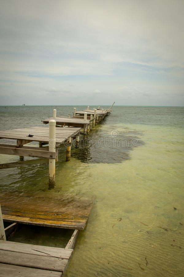 Vertical Shot of a Destroyed Pier. In Belize after a Storm stock photography