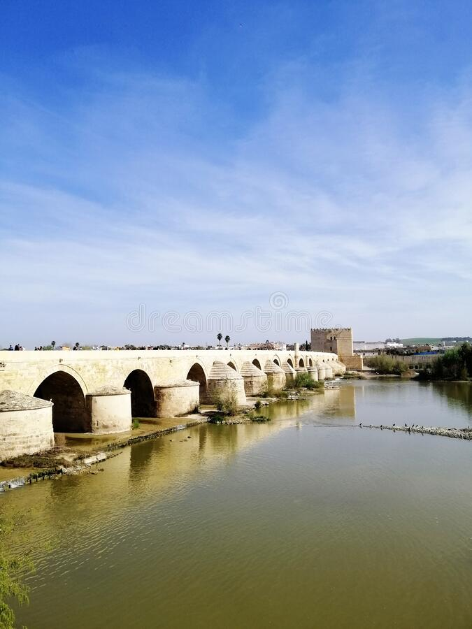 Vertical shot of the famous historic bridge in Cordoba, Spain. A vertical shot of the famous historic bridge in Cordoba, Spain royalty free stock image