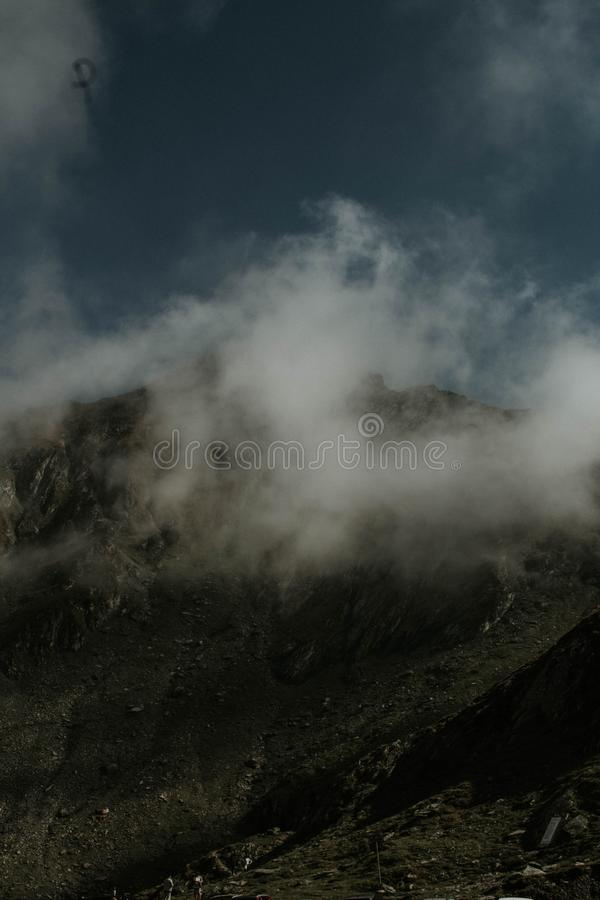 Vertical shot of foggy and misty mountains in the countryside. A vertical shot of foggy and misty mountains in the countryside stock photography