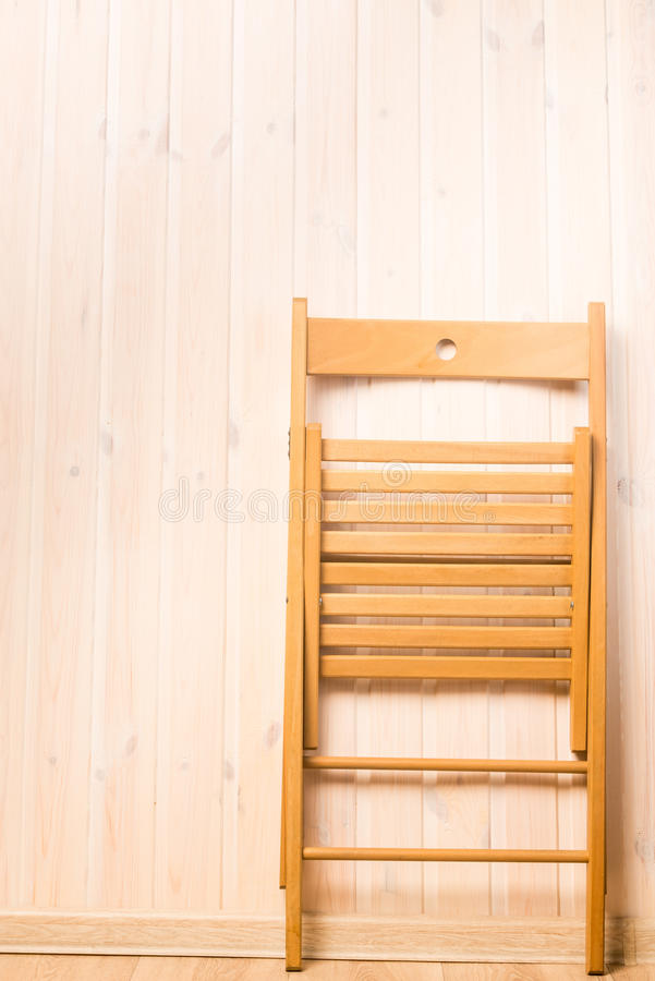 Vertical shot of a folding chair near the wall stock images