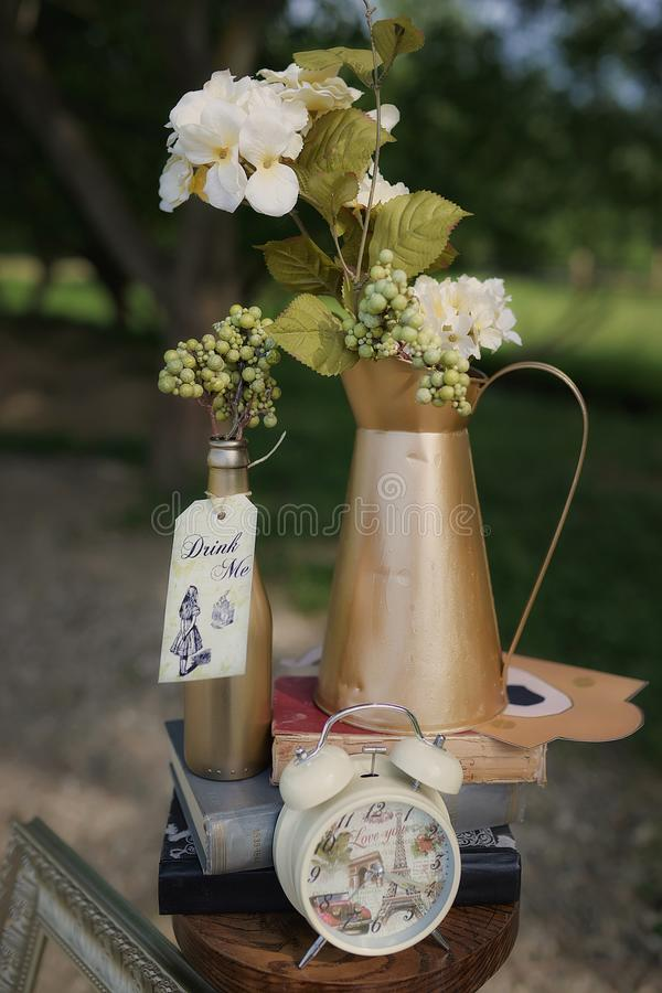 Vertical Shot Of Garden Decor Set For A Themed Event, With Detailed  Elements From Alice In Wonderland, Depicting Key Messages From The Popular  Children`s ...