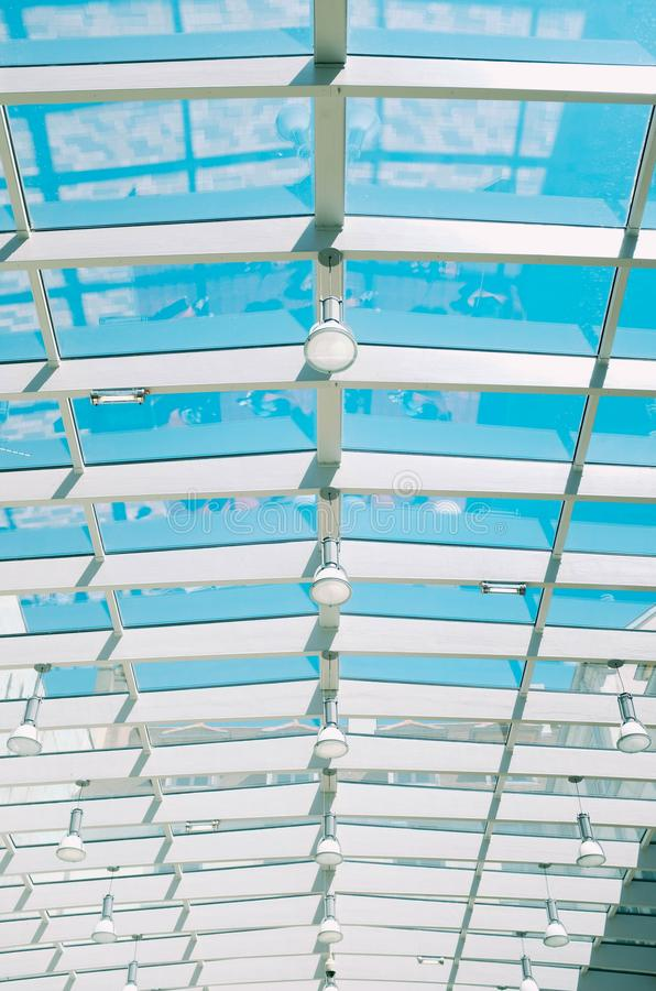 Vertical shot of a glass ceiling of an indoor swimming pool. A vertical shot of a glass ceiling of an indoor swimming pool royalty free stock photos