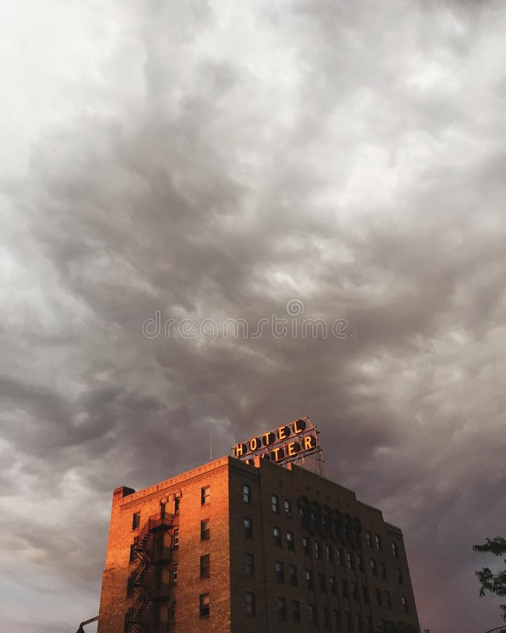 Vertical shot of a hotel building under a cloudy sky. A vertical shot of a hotel building under a cloudy sky royalty free stock image