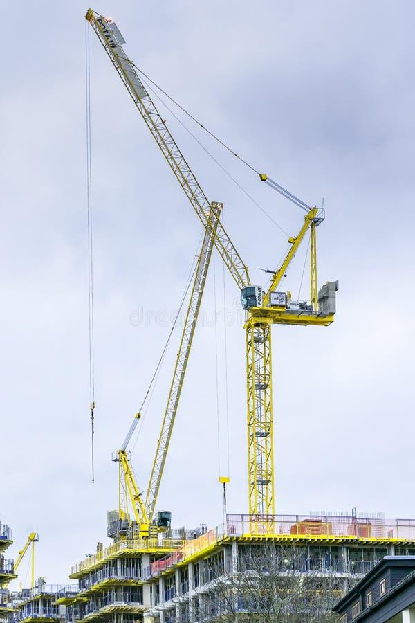 Vertical shot of a large yellow construction crane. A vertical shot of a large yellow construction crane stock photos