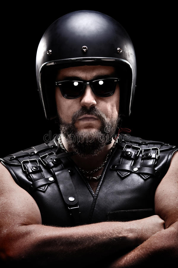 Vertical shot of a male biker with helmet stock photography