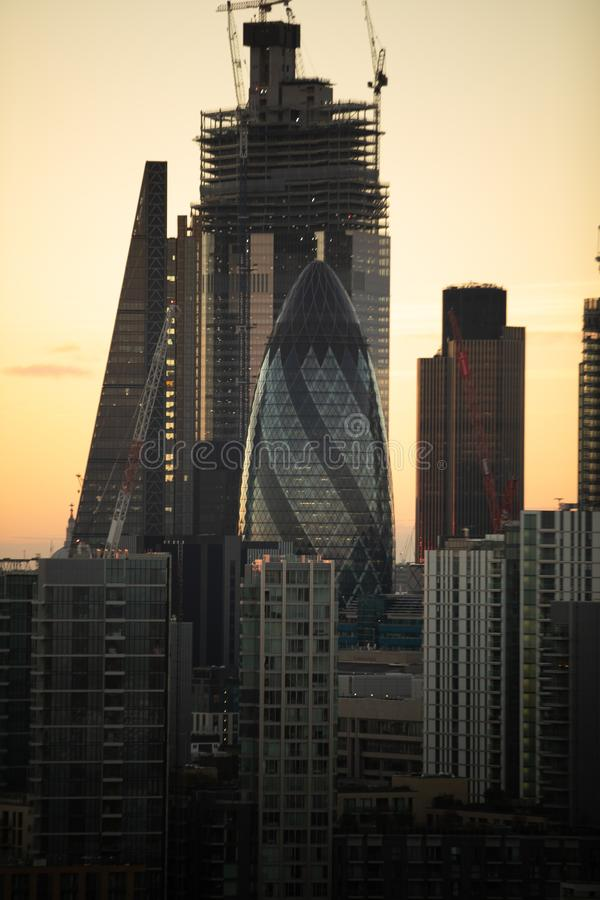 Vertical shot of modern architecture with high rise buildings at dusk. A vertical shot of modern architecture with high rise buildings at dusk stock images