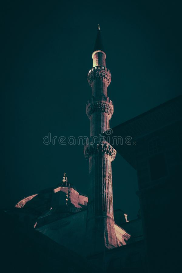 Vertical shot of the mosque tower at night time. A vertical shot of the mosque tower at night time royalty free stock images
