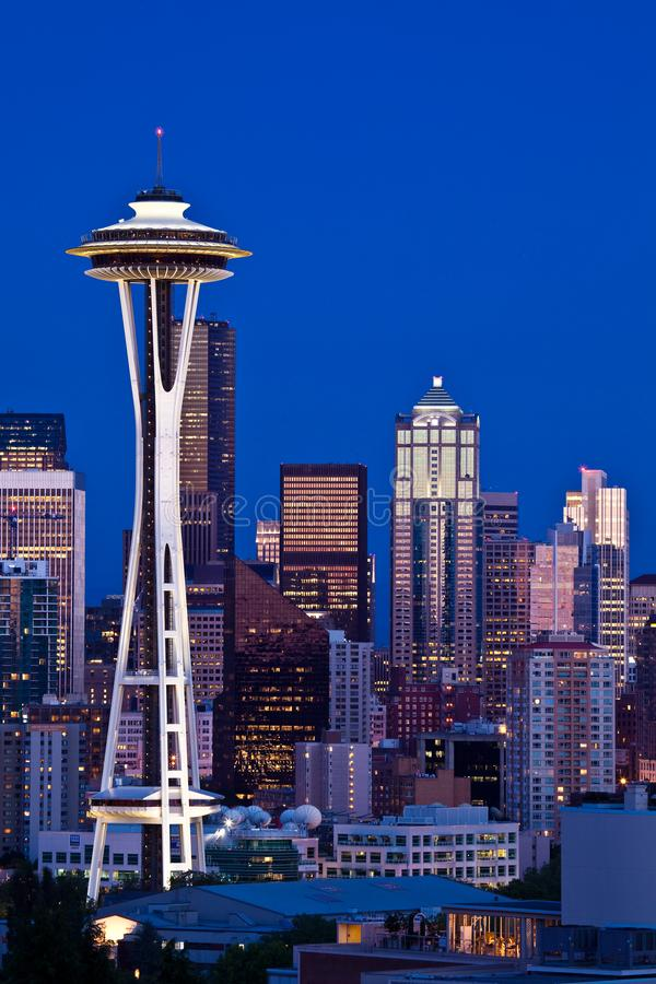 Space Needle tower in front of Seattle skyline at dusk royalty free stock photography