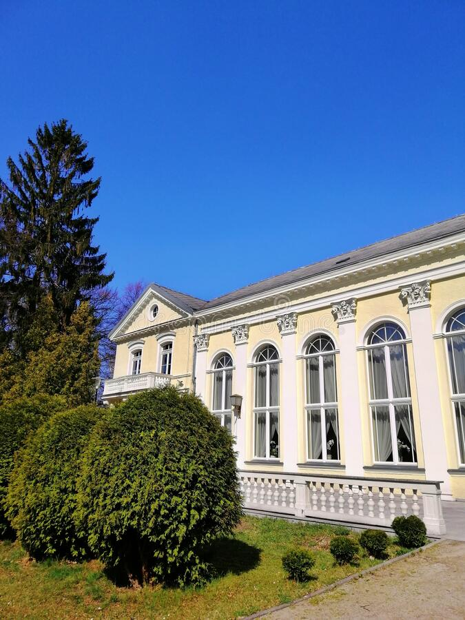 Free Vertical Shot Of The Hotel Wall And Garden Next To It In Spa Park, Jelenia Góra, Poland. Stock Images - 172213524