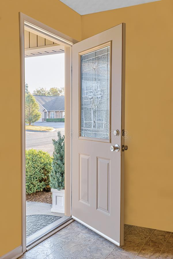 Friendly Open Front Door. Vertical shot of an open front door leading to the friendly neighborhood royalty free stock images