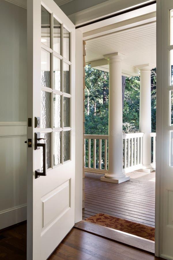 Vertical Shot Of An Open Wooden Front Door Stock Image