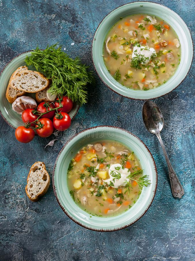 Vertical shot Pea soup with smoked meat, vegetables and greens. Delicious and healthy homemade food. Delicious and healthy homemade food. Vertical shot Pea soup stock photography
