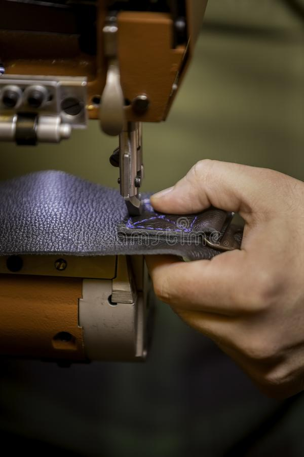 Vertical Shot of Sewing a Complete Box Stitch on Black Leather stock photos