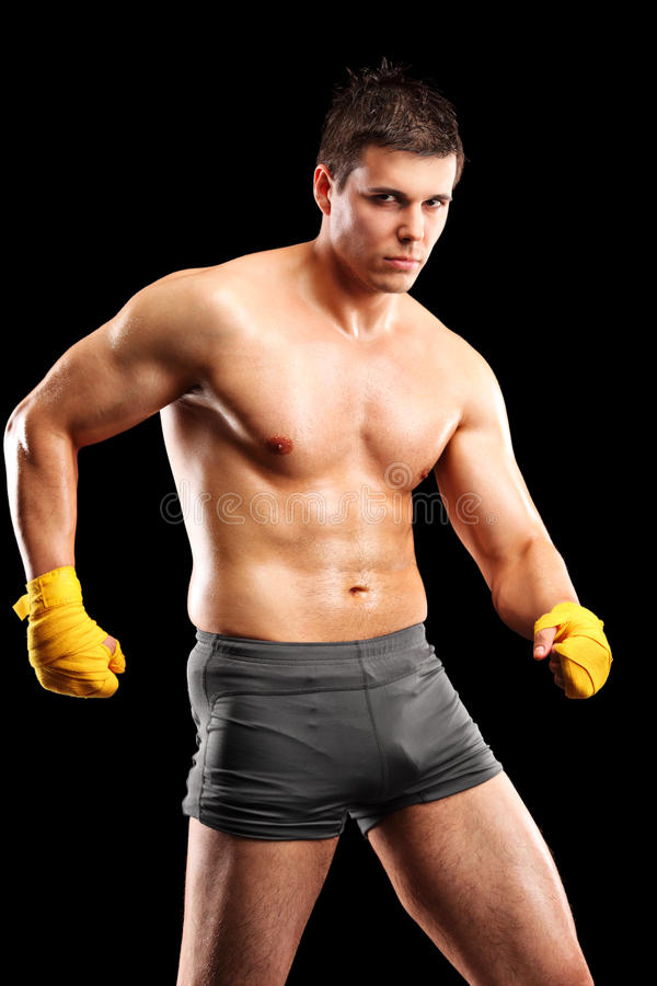 Vertical shot of a shirtless male fighter royalty free stock image