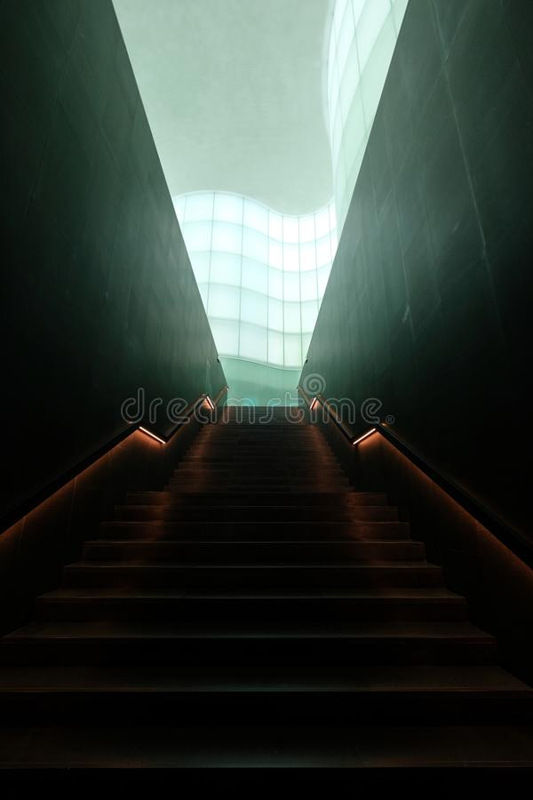 Vertical shot of a staircase in a modern building. A vertical shot of a staircase in a modern building royalty free stock images