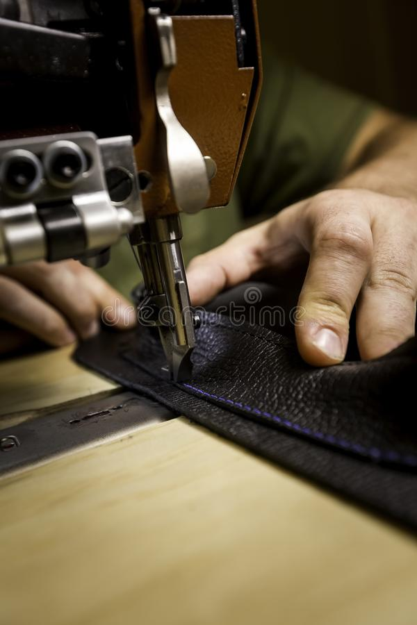 Vertical Shot Adding Leather Pocket Using a Commercial Sewing Machine royalty free stock photos