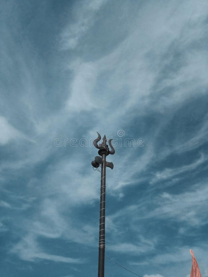Vertical shot of a trident under a cloudy sky. A vertical shot of a trident under a cloudy sky royalty free stock photo