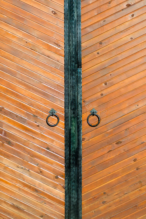 Vertical shot Vintage wooden door with the ring royalty free stock image
