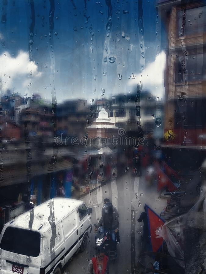 Vertical shot of a window with water trails and a blurred background. A vertical shot of a window with water trails and a blurred background stock images