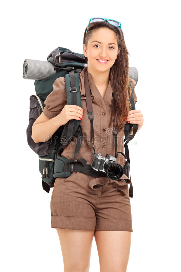 Vertical shot of woman carrying hiking equipment. Isolated on white background royalty free stock photos