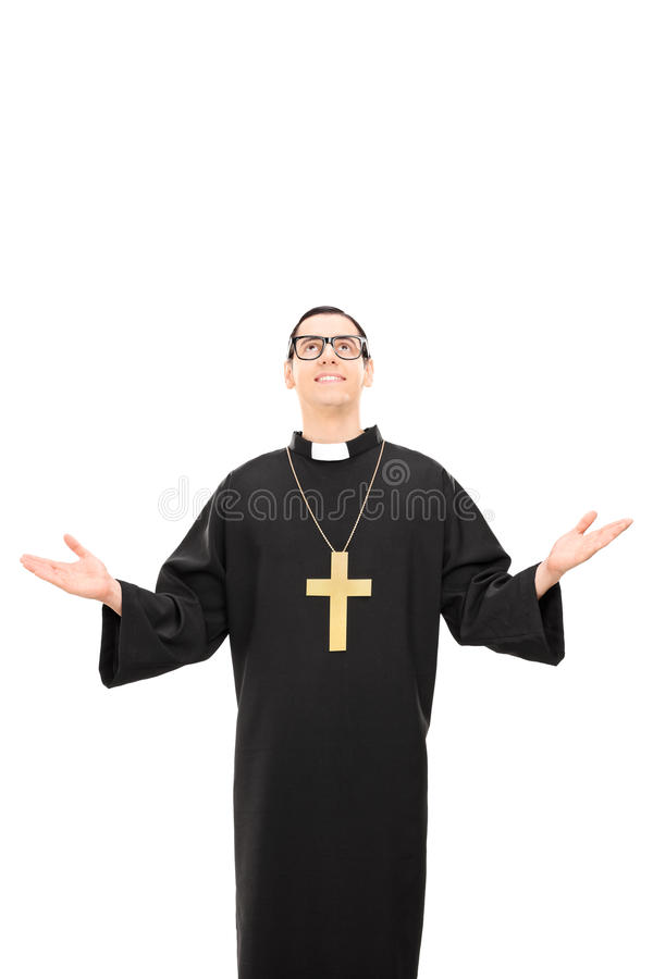 Vertical shot of a young catholic priest looking up. Isolated on white background royalty free stock photos