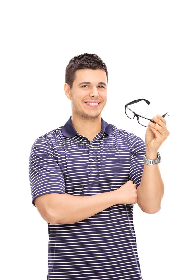 Vertical shot of a young man holding glasses. Isolated on white background royalty free stock image