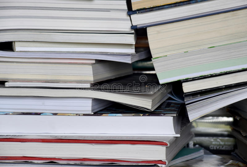 Vertical stack of books in a pile stock photos